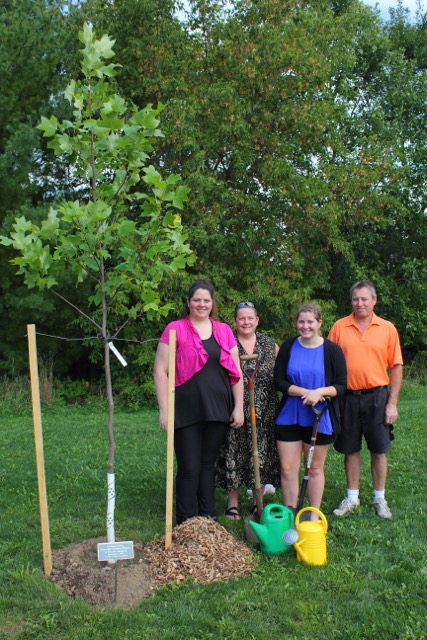 The Rogers Family  celebrate their neighbourhood by adding a Tulip Tree to Drimmie Park, Elora.