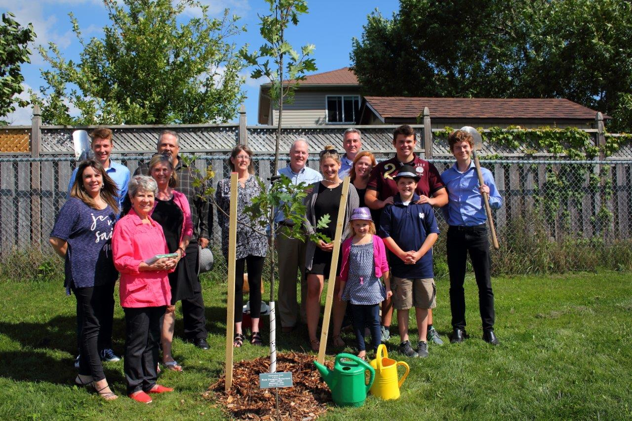 Joan McWilliam and her family with their second tree in Pattison Park, Fergus.