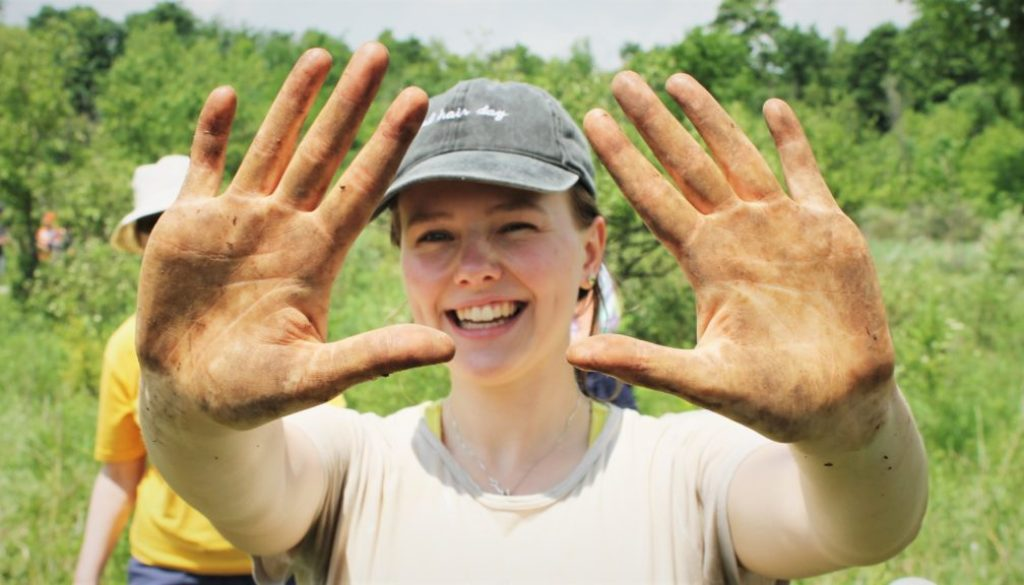neighbourwoods volunteer showing off her dirty hands