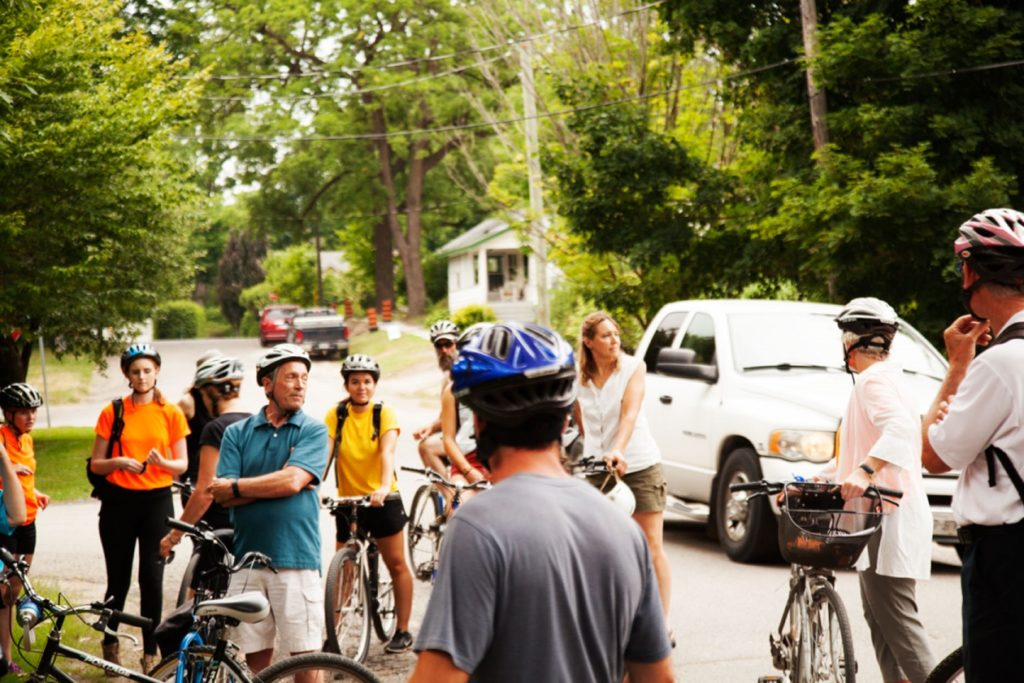 group of cyclists and volunteers during the Tour The Trees